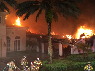 PHOTOS: Mansion gutted by fire in Palm Beach Co.