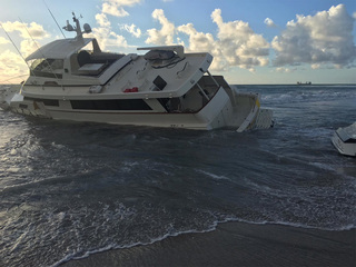 Crews continue efforts to remove grounded yacht