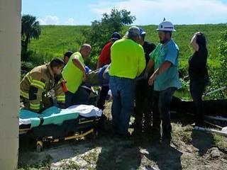 Worker pinned by backhoe rescued