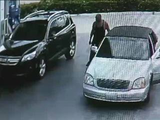 VIDEO: Woman leaps on thief's car at gas station