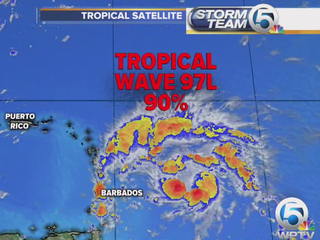 Tropical Wave continues to develop, moving west