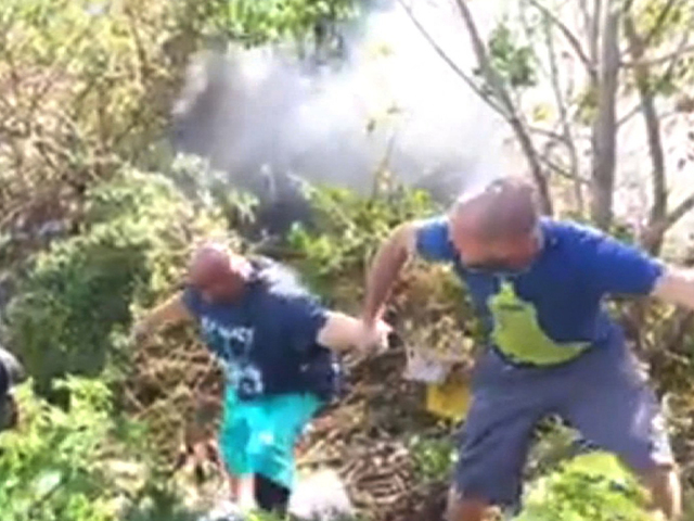 Police, bystanders rescue driver from fiery crash