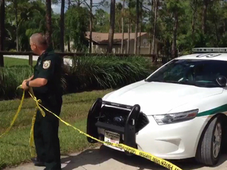PHOTOS: UPS driver finds body in Jupiter Farms