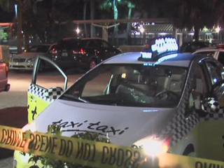Taxi cab hit by bullets near West Palm Tri-Rail