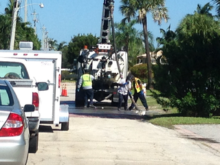 Workers clean up sewage spill on Singer Island