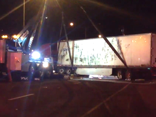 PHOTOS: Semi driver falls asleep, wrecks on I-95