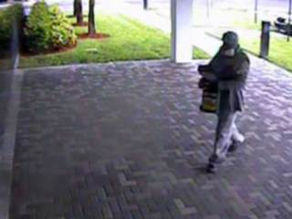 Man wearing gas mask robs IBM Credit Union in Delray Beach, police ...