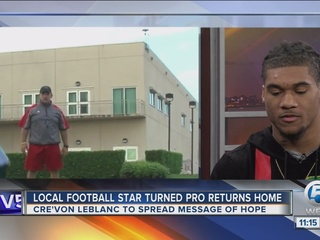 Glades football star returns home with message