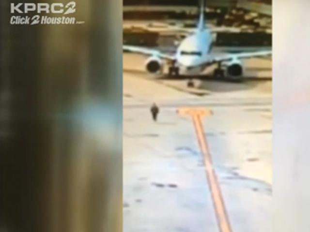 Woman jumps from plane's emergency door