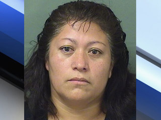 Mom charged after 13-year-old found behind wheel