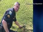 Police rescue stuck iguana