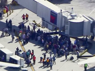 More 911 calls released in airport shooting