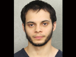 Airport shooting suspect gets public defender