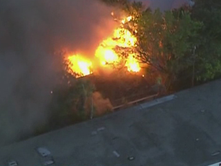 Crews battle house fire in Riviera Beach