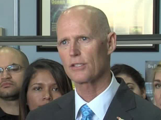 Scott touts plan to lower costs of education