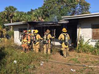 Firefighters extinguish blaze at abandoned house