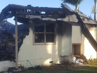 Firefighters extinguish Loxahatchee house fire