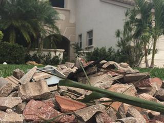 Storms shatter car windows in Palm Beach Gardens