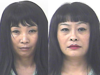 Massage parlors busted, two women arrested