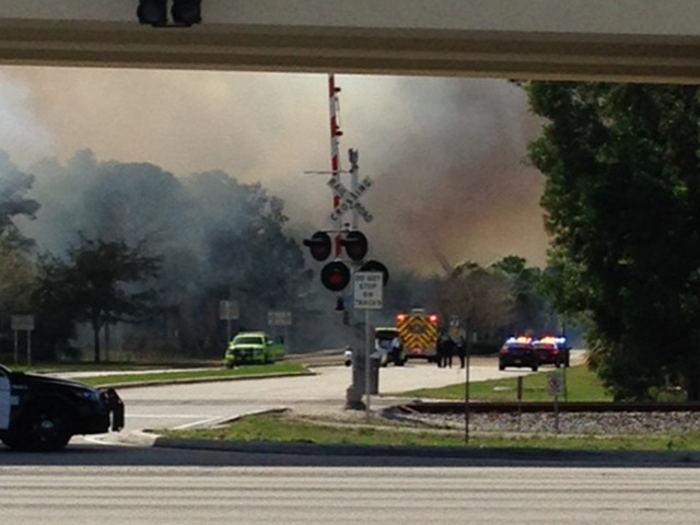 Firefighters battle brush fire in Palm Beach Gardens