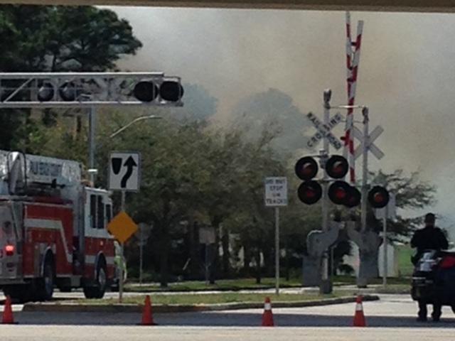 Firefighters battle brush fire in Palm Beach Gardens