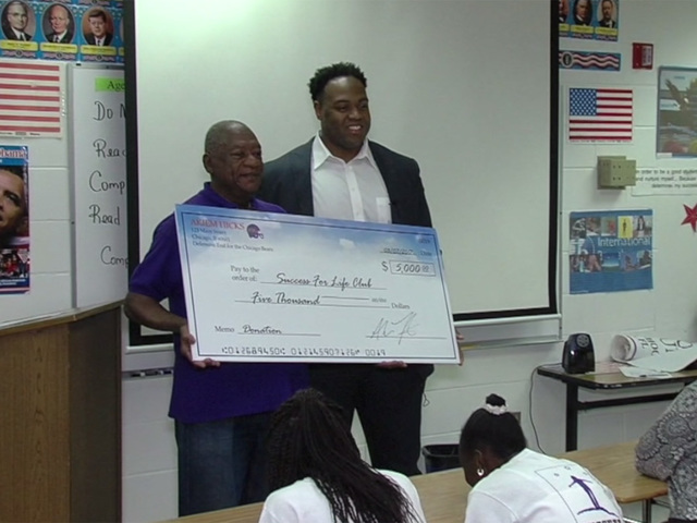 NFL player donates money and advice to middle school group preparing…