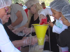 Volunteers pack thousands of meals to donate