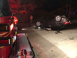Car lands on roof after West Palm Beach crash