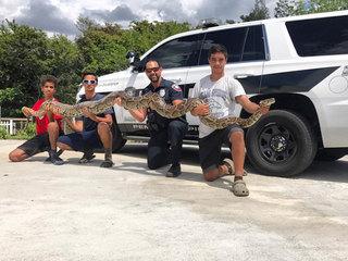 South Florida kids wrangle 13-foot python