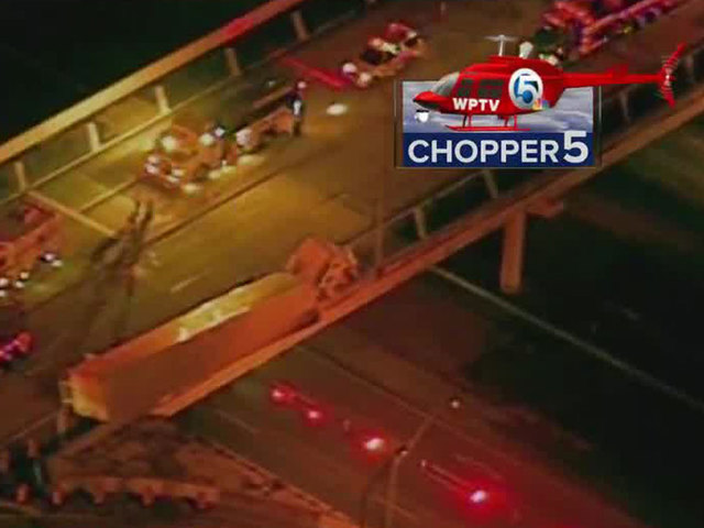 1 dead as semi dangles off overpass in Boca Raton