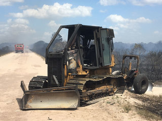 Fire destroys dozer, firefighter escapes injury