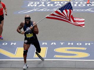 Marine amputee runs Boston Marathon with US flag