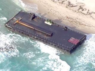 PHOTOS: Barge washes onto Singer Island