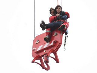 Woman climbs crane, needs to be rescued