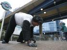 Guy in gorilla costume crawls through Marathon