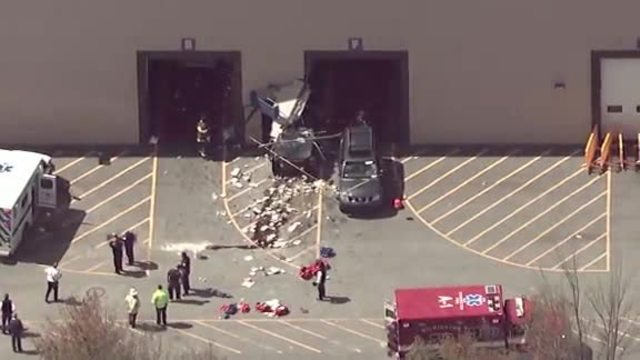 Vehicle  crash at auto auction leaves three dead in MA