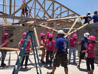 Women volunteer to build homes for Boynton moms