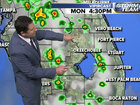 Humid and breezy with late day storms