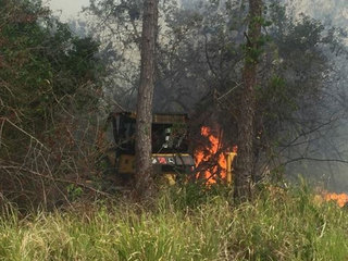 Wildfire threatens home in Indian River County