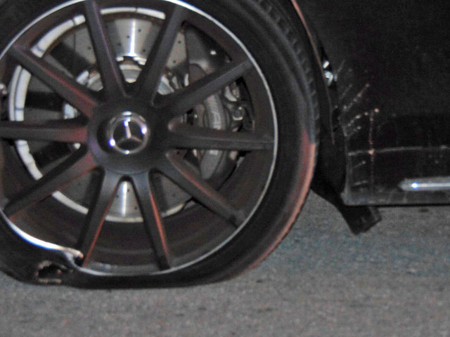 New photos show flat tires on Tiger Woods' car during DUI arrest