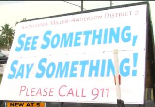 Man installs 'see something, say something' sign