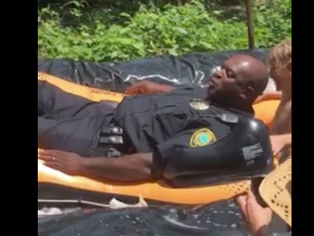 North Carolina Police Officer Takes a Plunge on a Slip-N-Slide