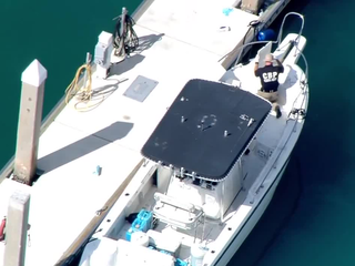 Customs checks out boat towed to shore