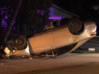 Car flips, lands on its roof in Lantana
