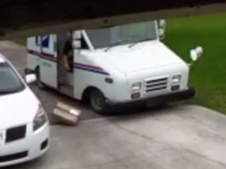Camera captures mail carrier tossing package