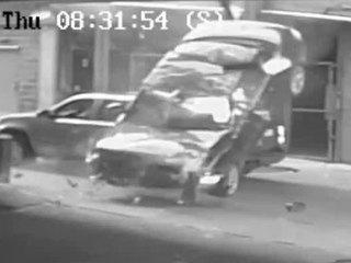 VIDEO: BMW violently plunges off parking garage