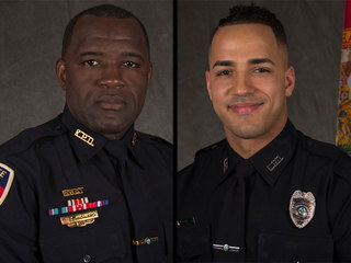 People honor two officers who died in shooting