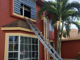 Firefighters cut into storm shutters to save man