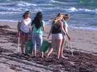 Volunteers perform beach cleanup on Palm Beach