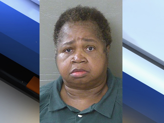 Cops: 325-pound woman sat on girl, killed her
